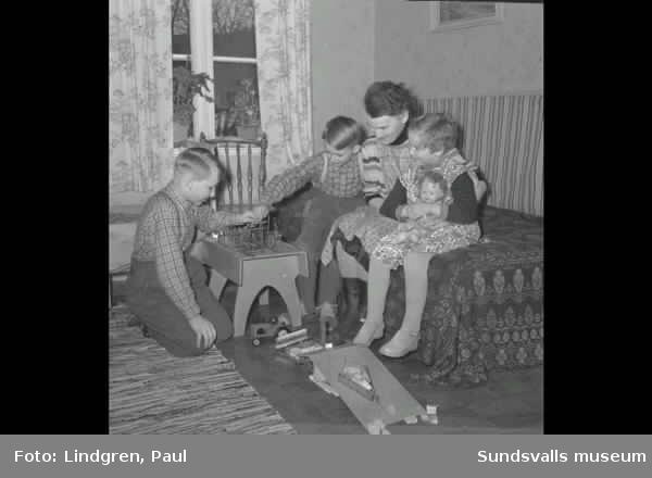 Vårbild. Vy över Uneåsen, Liden. Bro, samt mor med barn.