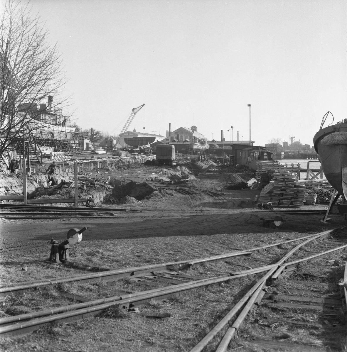 Övrigt: Fotodatum:19/2 1959 Byggnader och Kranar. Slipens omläggning av spåren.