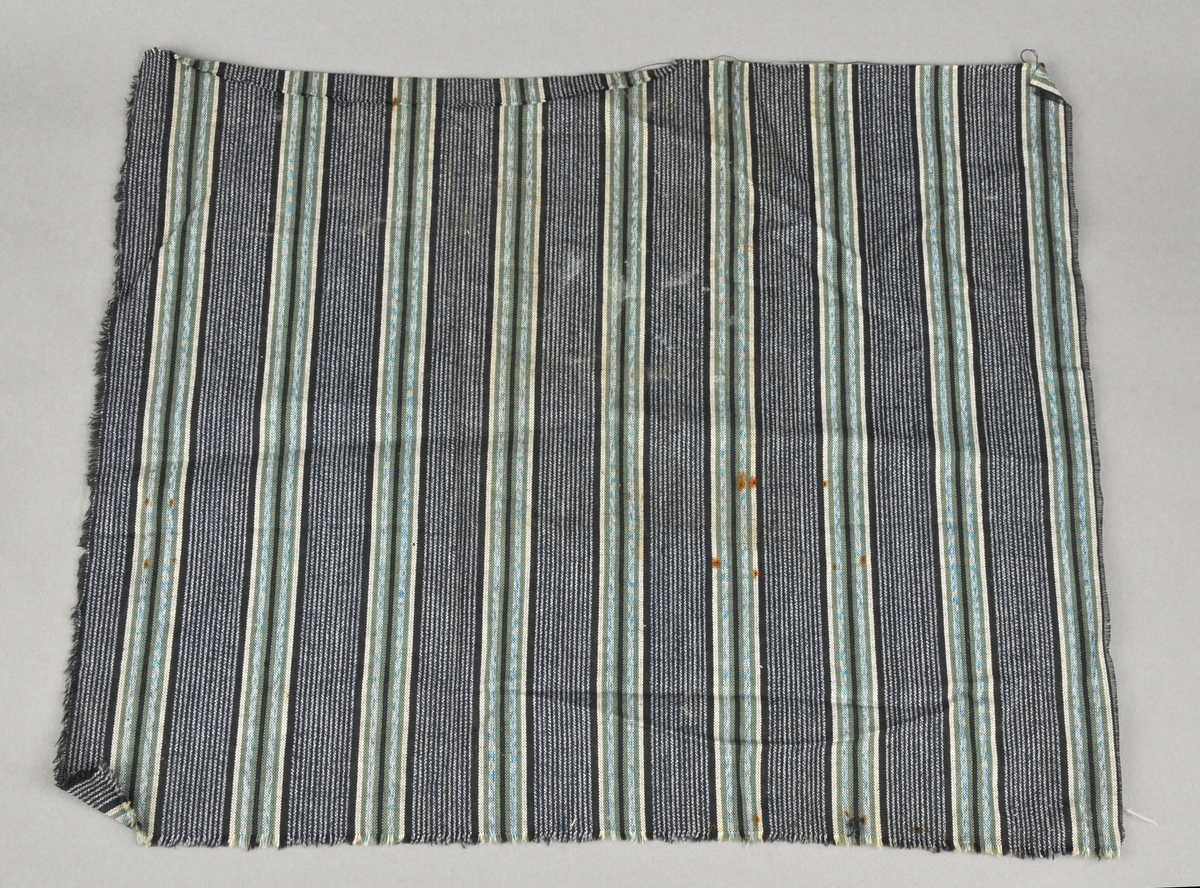 Rektangulært tøystykke. Ubruka. Striper.