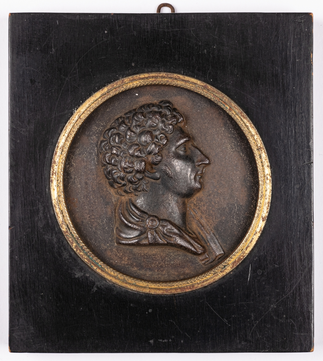 Porträttmedaljong, relief i järn, föreställande Karl XIV Johan, inom svart träram.