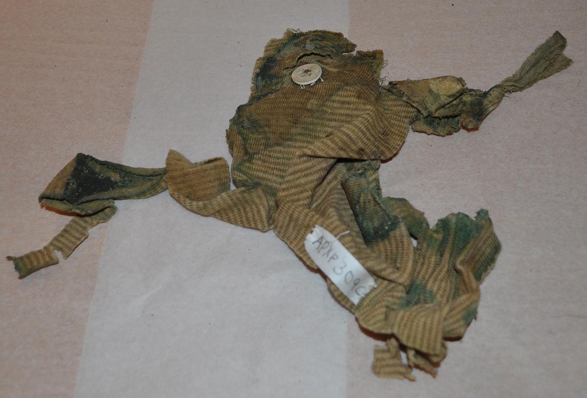 B. Randiga långkalsonger i två delar. Trasiga och smutsiga. A: Fragment