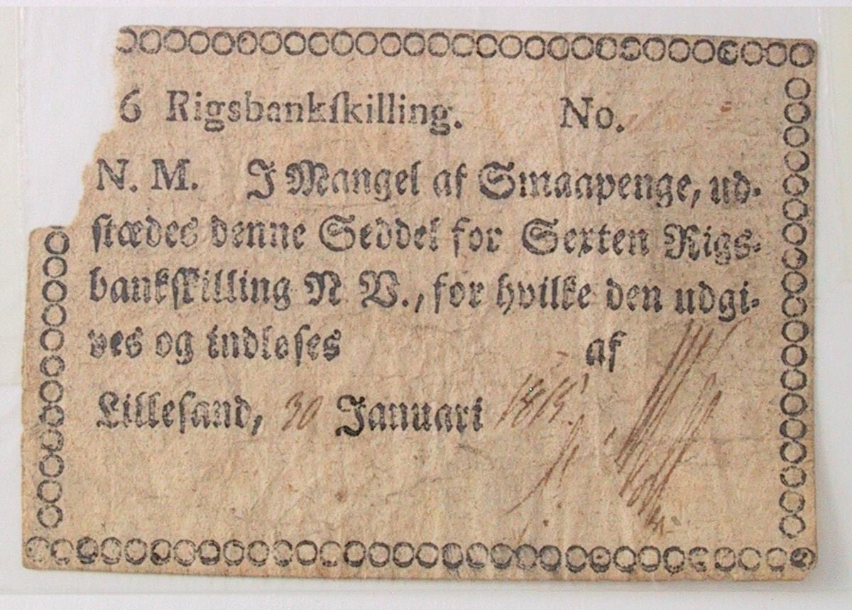 Gotisk trykk. Ramme bestående av ringer. Øverst 16 Rigsbankskilling. Datert Lillesand 30.Januari 1815.