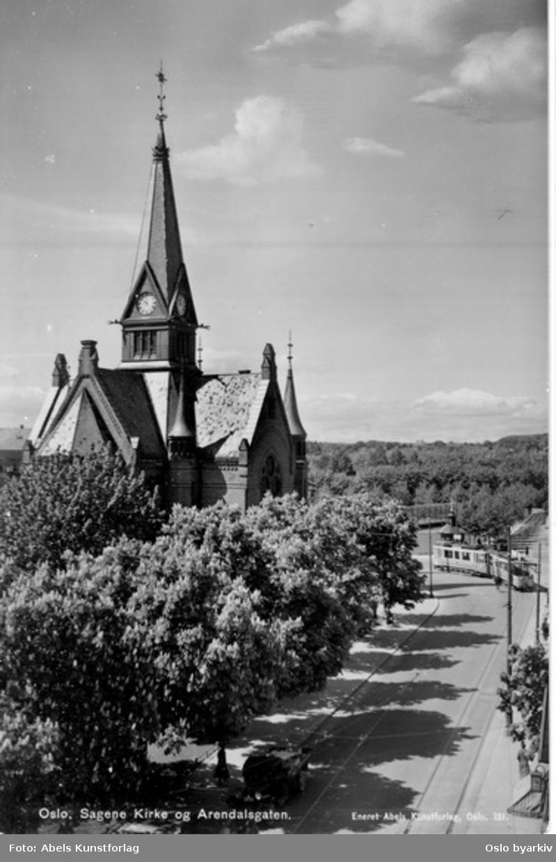 Sagene kirke, Dannevigsveien 17, parkområde. Sagenetrikk svinger inn i Kierschows gate fra Arendalsgata ved Gråbeinsletta. Postkort.
