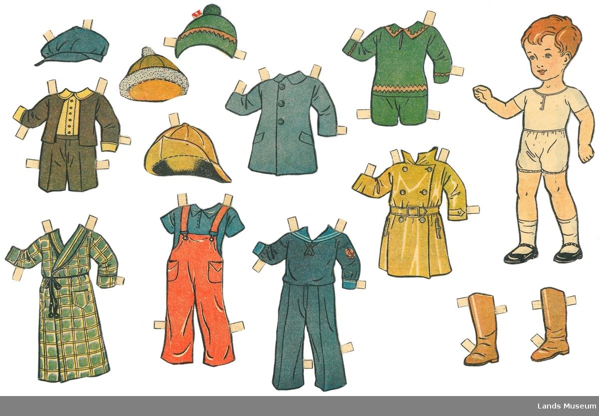Papirdukke med klær klipt ut frå utklippsark.  A- dukke, gutt, 16,5 x 8 cm B- gul regnfrakk, 8,5 x 7,5 cm C- gul sydvest, 3,5 x 6 cm D 1 og 2- eit par gule støvler, 5 x 2,5 cm E- strikket sportsdress, grønn, 7 x 7,5 cm F- matrosdress, blå, 11 x 7,5 cm G- lue til grønn strikkedress, 2,5 x 4 cm H- overrall, rød, 11 x 5,5 cm I- frakk, blå, 7 x 7 cm J- lue, blå, 2,5 x 5,5 cm K- søndagsdress, 7 x 7 cm L- lue, 4 x 5 cm M- badekåpe, 10,5 x 7,5 cm  Det er skrevet på baksida namn på alle klærene og kva hodeplagg som passer til dei ulike klærene. Bak på dukken er det skrevet namnet Per med blyant.