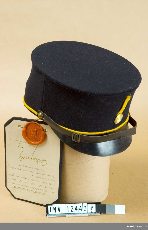 Grupp C I. Ändringsmodell t mössa m/ä-1923 t uniform m/ä f manskap med vederlikar vid I 6, I 28, K 4, K 5, K 7. Fastställd gm GO nr 1805/1923, 1923-12-14. Från intendenturens modellkammare.