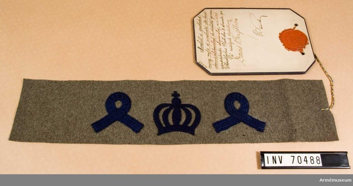 Grupp C.I.  Modell på gradbeteckning m/1911 på armbindel för landstormslöjtnant fastställd genom generalorder nr 1540 den 30 december 1911.