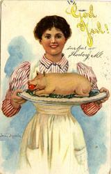 """""""God Jul!"""" Kvinna bjuder på en av högtidens specialiteter på"""