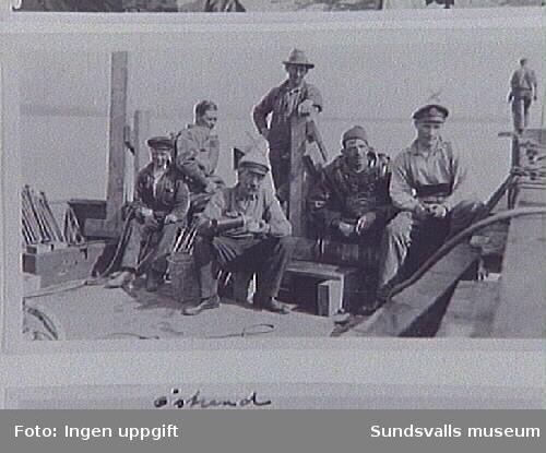 Dykarlag, kajbygge vid sulfatfabriken i Östrand, Timrå. Dykare Nyberg i mitten. Järnbultarna t.v. användes vid hopbultning av kajen.