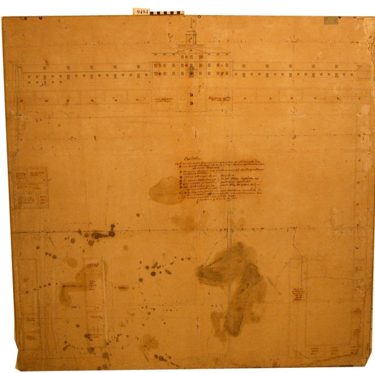 Ritning över Tyghuset på Karlskrona örlogsvarv med verkstäder, skrivkammare och bodar. Utförd på papp, klistrad på skiva av trä. Utförd av tygmästaren vid Karlskrona örlogsvarv J E  Thornqvist, den 6 augusti 1757.  Signerad J E Thornqvist