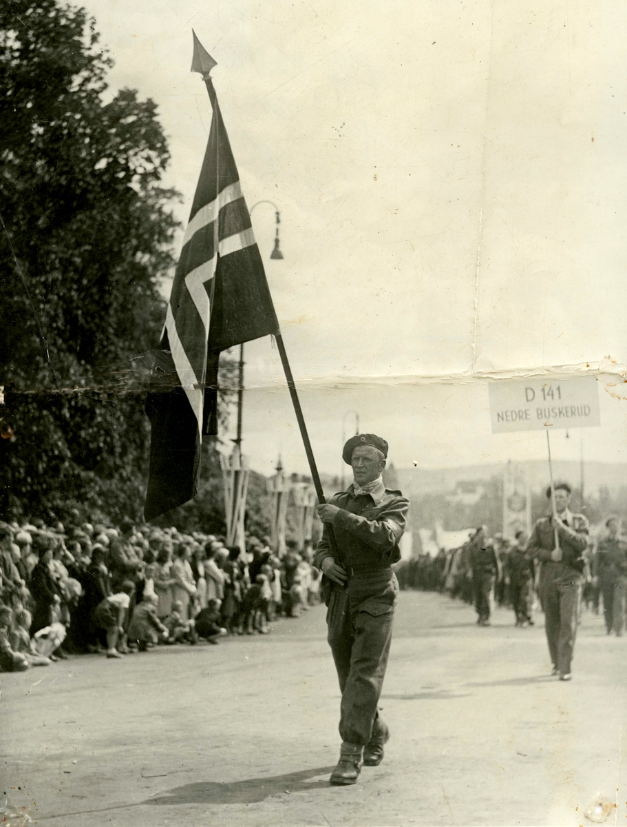 Flag bearer Birger Ruud during the parade of the Home Forces (Resistance forces) in Oslo