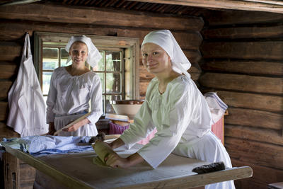Two women baking lefse