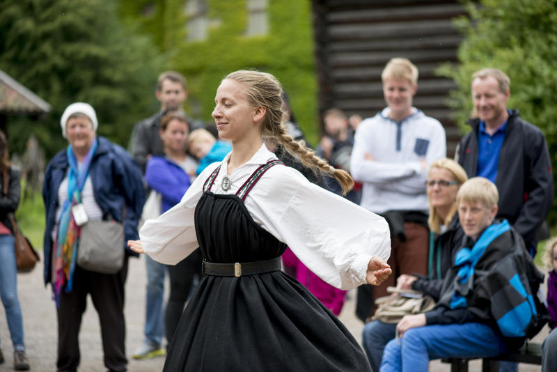 Woman dancing folk dance in national costume