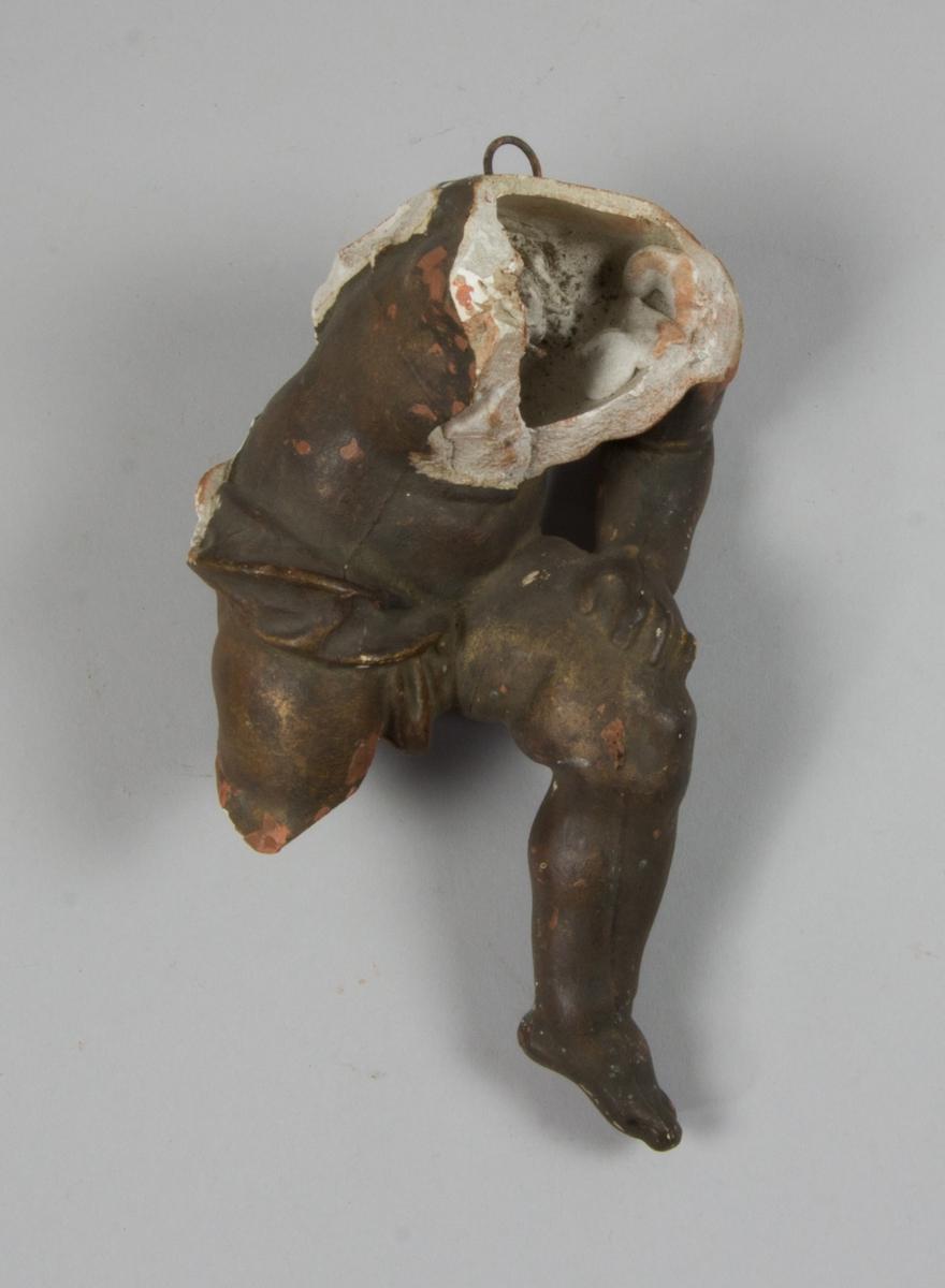 Studiemodell, torso av bronsmålad gips. Otydligt om studien avbildar barn eller vuxen.