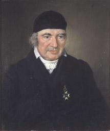 Portrett av Lauritz Weidemann. Mørk drakt, svart hodeplagg, kalott.. Orden (Nordstjerneordenen) på brystet. (Foto/Photo)