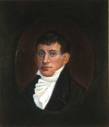 Portrett av eidsvollsmann Christopher F. Omsen.  Mann med kort, mørkt hår, mørk kledning og hvit skjorte med hvitt halsbind, kalvekryss  Innskrevet i oval.