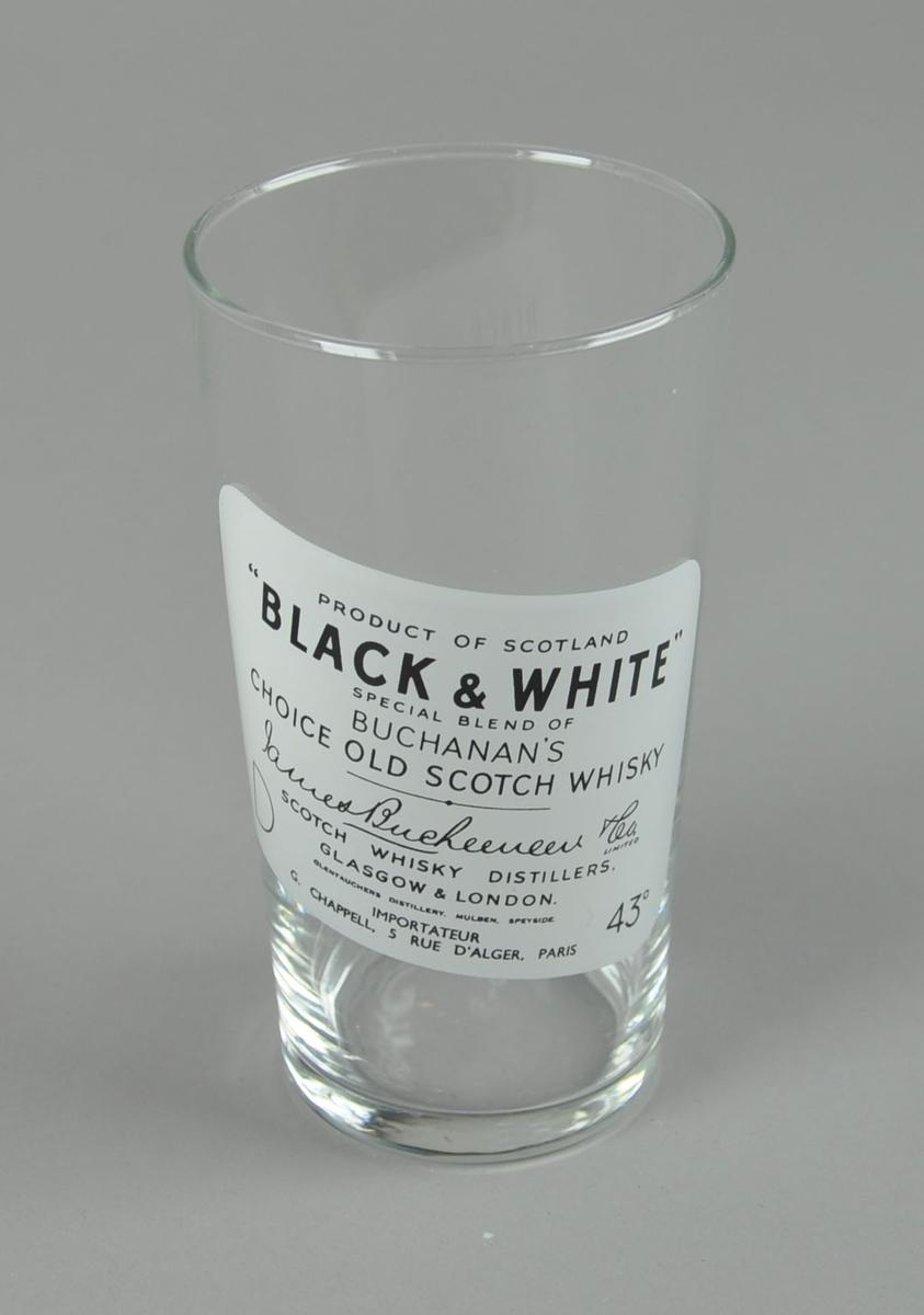 Drikeglass med whiskymotiv, utstående glass.