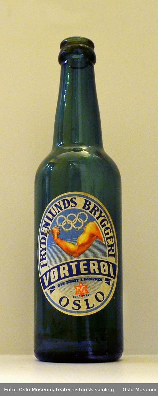 Bilde av en arm med de olympiske ringer over.