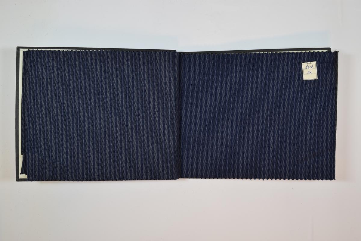 Prøvebok med 8 stoffprøver. Tynne stoffer i mørke farger, mønstret med vertikale striper.  Stoffprøvene ligger brettet dobbelt i boken slik at vranga dekkes. En firkantet papirlapp hvor nummer er påskrevet med penn er festet til stoffet med metallstifter.   Stoff nr.: 864/30, 864/31, 864/32, 864/33, 864/34, 864/35, 864/36, 864/37.