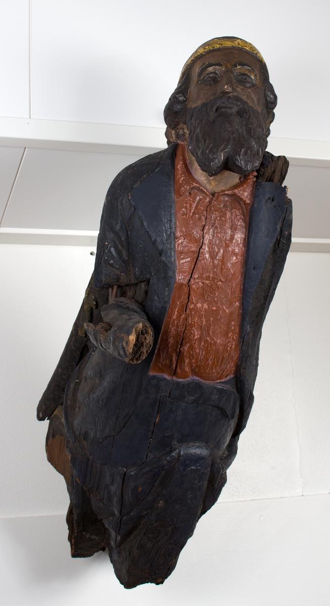 Mannsfigur i flere farger, utstrakt høyre arm.