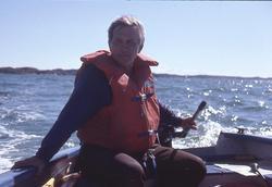 Museichef Carl Cullberg i en båt på Gullmarn