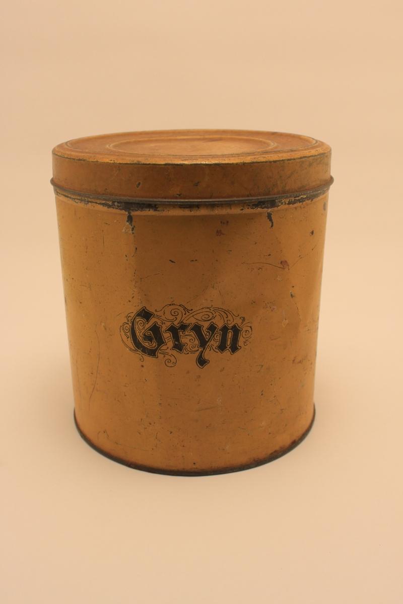 Gul cylindrisk plåtburk med lock för Gryn.