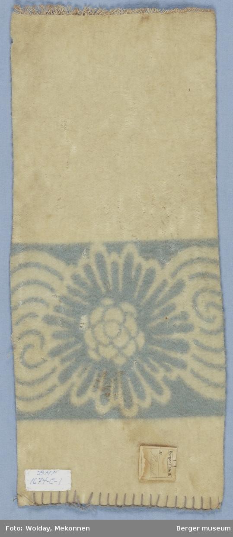 Ullteppe 1 prøve Ensfarget teppe med blomsterbord