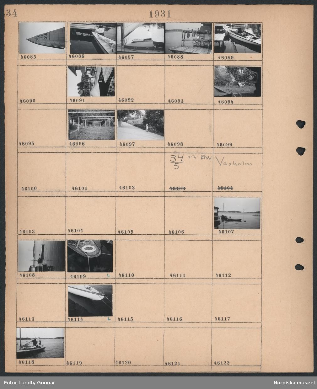 Motiv: Vaxholm; Hamn med båtar, en person sitter i en solstol, torkställning för fisknät, ett barn går på en grusväg.  Motiv: Vaxholm; Hamn med båtar, detalj av segelbåt.