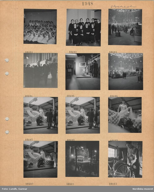 Motiv: Stockholm, gruppbild av unga kvinnor i sköterskeuniform, gruppbild av medelålders och äldre kvinnor i sköterskedräkt med kransrosett på bröstet, utställningshall med montrar och besökare, en grupp män i kostym, monter som visar uppvärmning, monter med skyltdocka vid mangel, besökare sitter i stol och läser, utomhusscen med orkester kvällstid, stående åhörare, interiör cykelverkstad, ung man hanterar en cykel.