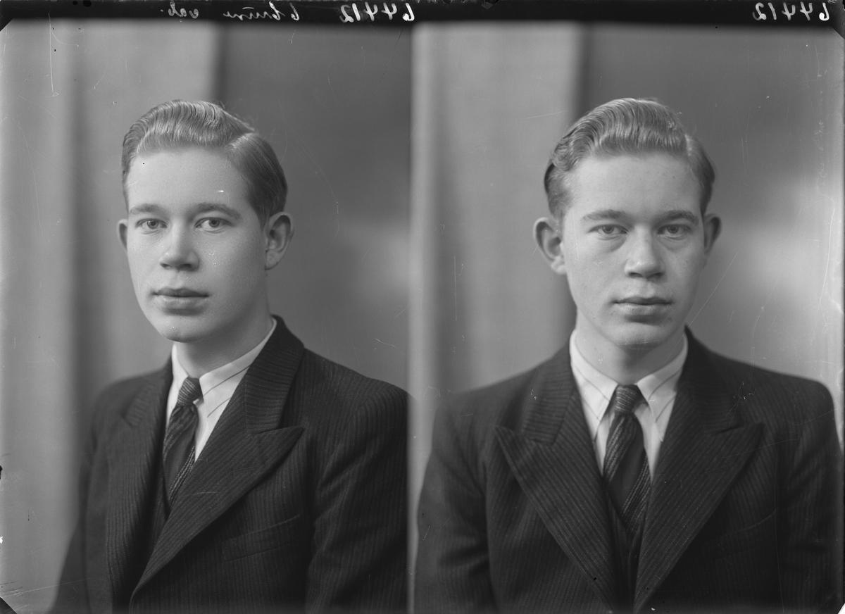 Portrett. Ung mann i mørk dress, vest og slips. Bestilt av Olaf Kvindesland. Erling Skjalgsonsgt. 29.