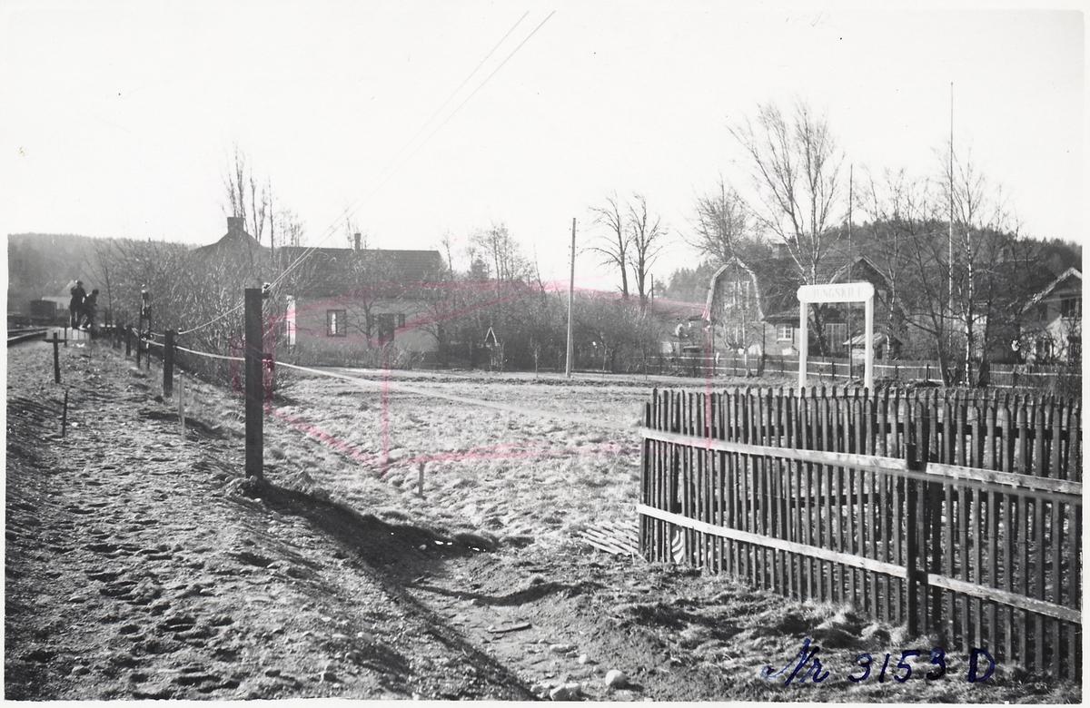 Landskap med hus i Ljungskile.