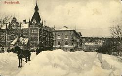 Vykort med vintermotiv över parti av Sundsvall.