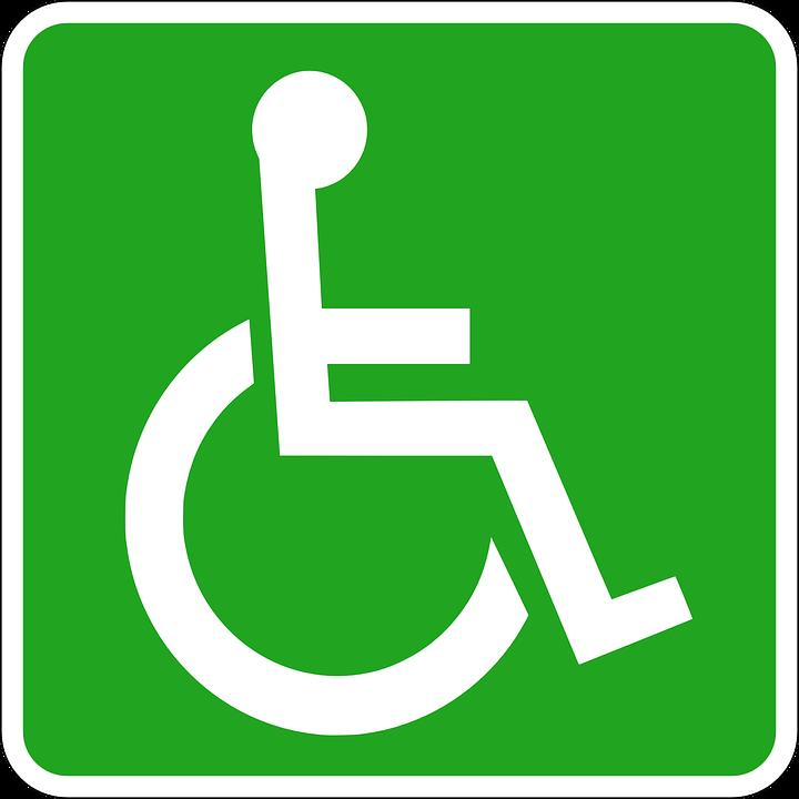 Grønt skilt med hvitt rullestolsymbol.