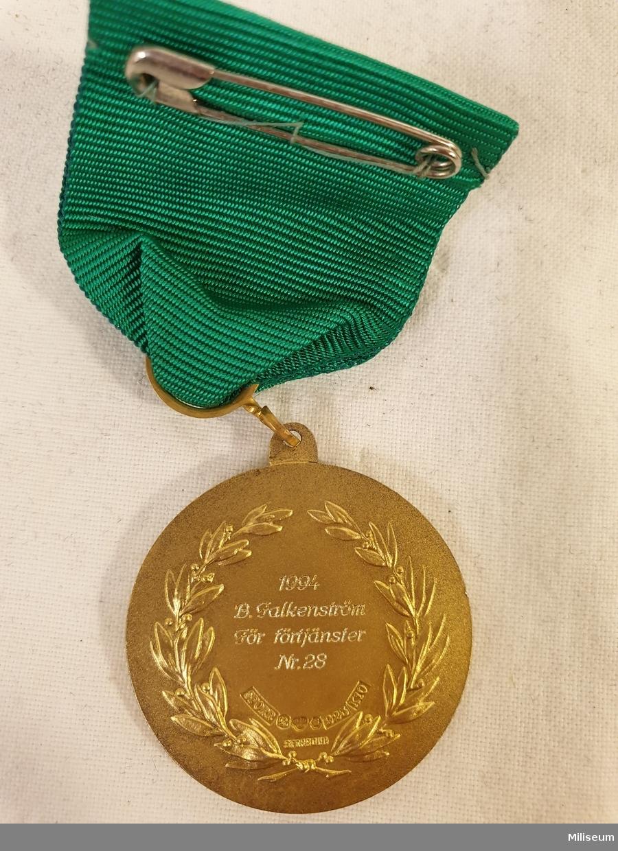 Pistolskytteklubben Sveas förtjänstmedalj i valören guld, tillverkad av förgyllt silver 1987.