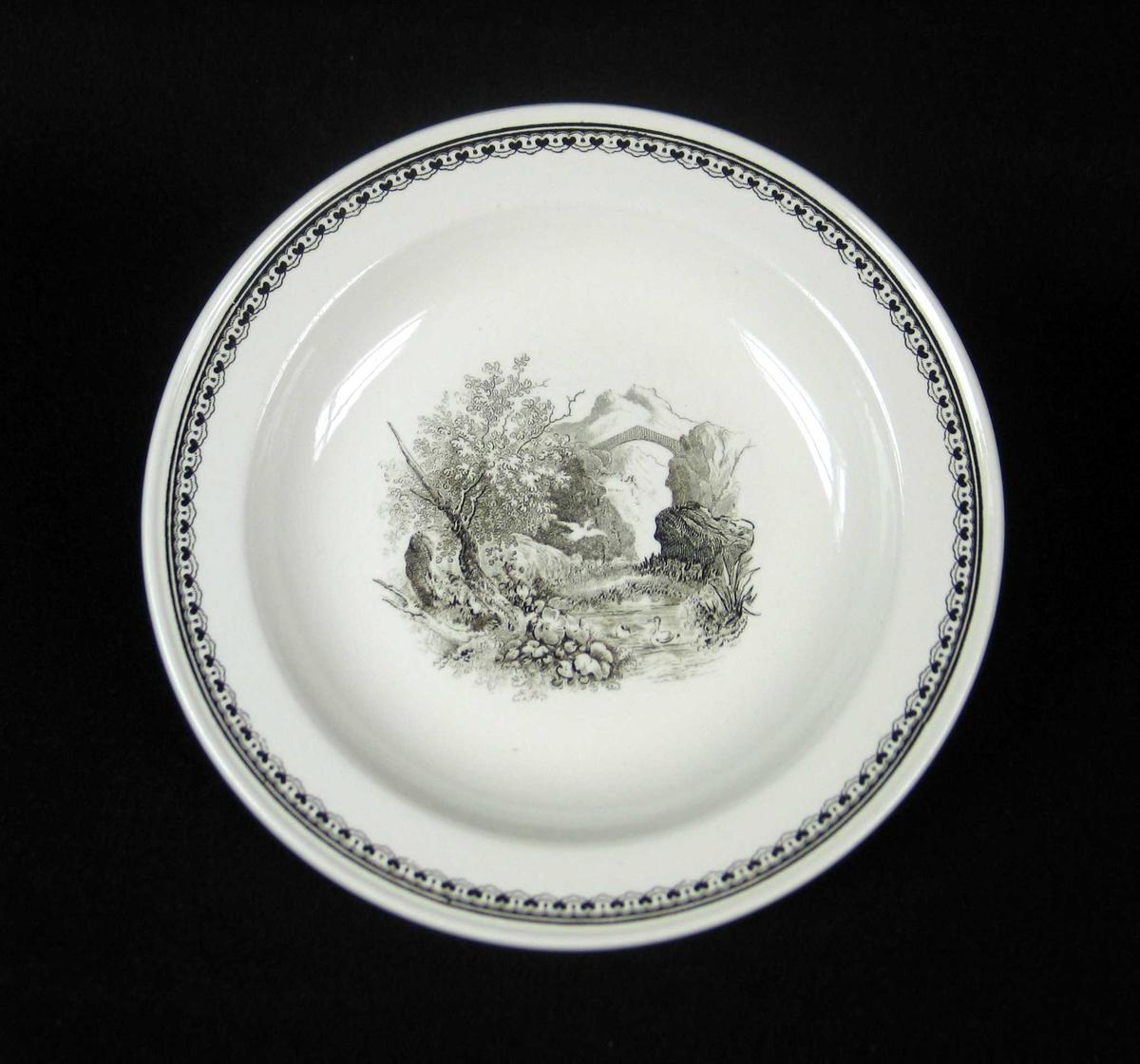 Dessertallerken i offwhite keramikk med sort dekor.