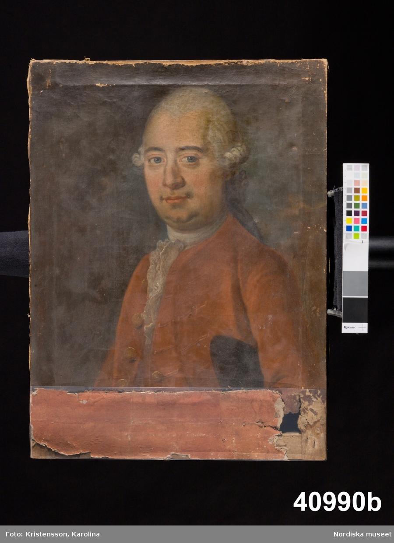 Porträtt av man, midjebild.