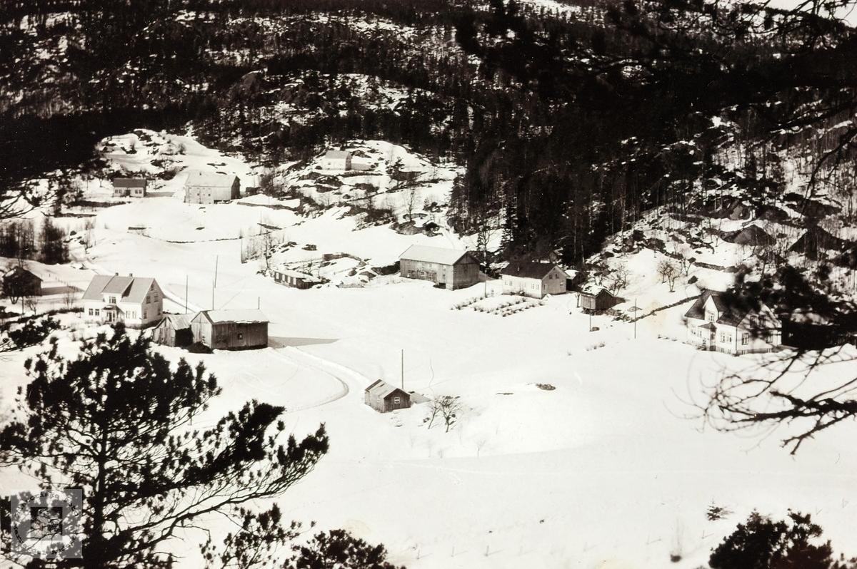 Vinterbilde fra grenda Håland i Grindheim Audnedal