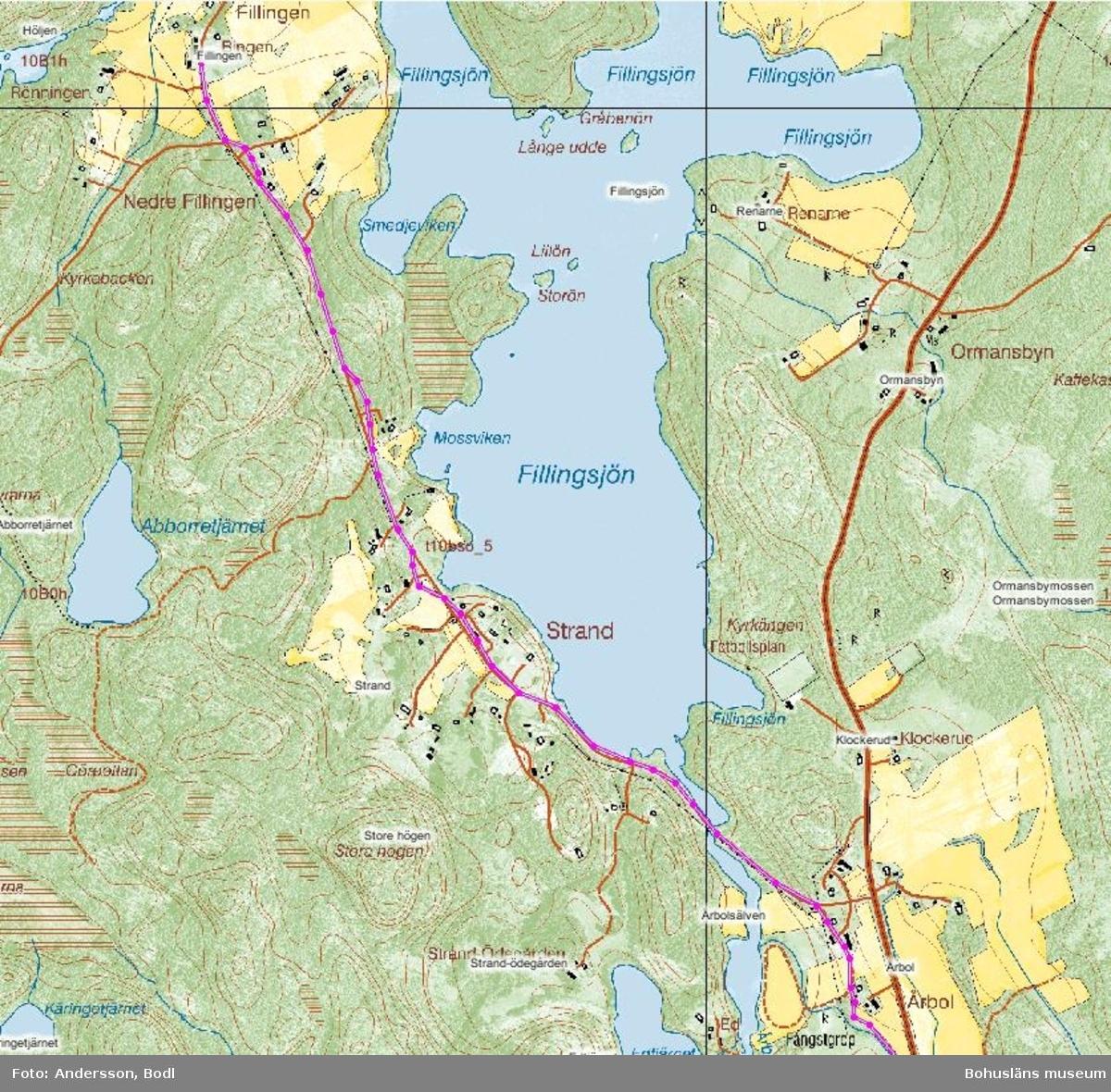 Den rosafärgade markeringen visar den tidigare Skojarevägens sträckning genom området.