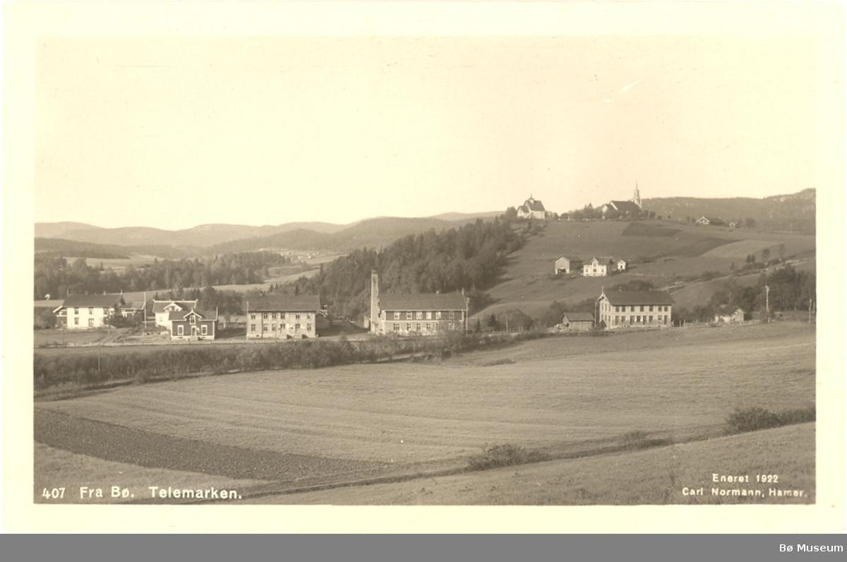 Bø sentrum med kyrkjene, Bø i Telemark, to ulike utgåver av same postkort.
