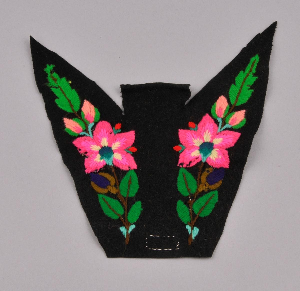 Broderi på svart klede, del av bakstykke til eit draktliv. Motivet er blomar og blad i sterke fargar.