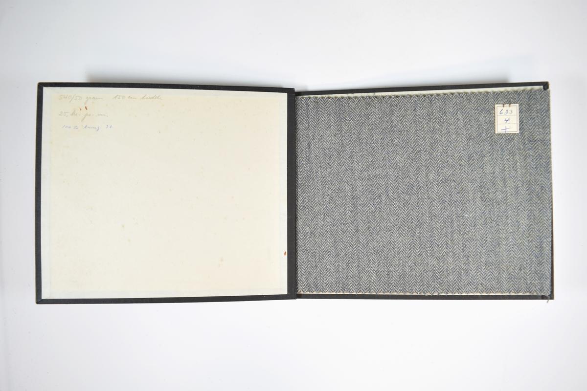 Prøvebok med 2 stoffprøver. Middels tykke stoff med fiskebensmønster. Stoffene ligger brettet dobbelt slik at vranga skjules. Stoffene er merket med en firkantet papirlapp, festet til stoffet med metallstifter, hvor nummer er påført for hånd.   Stoff nr.: 633/4, 633/5.