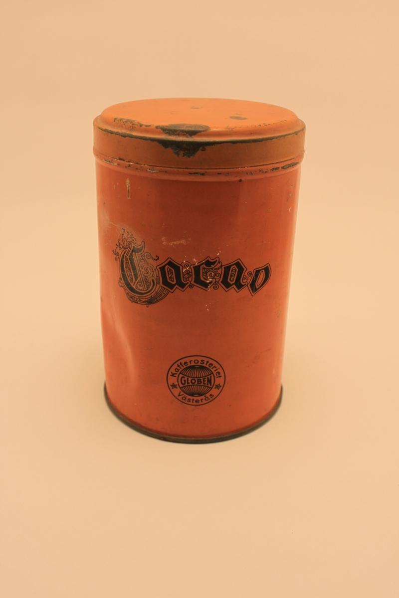 """Cylinderformad orange plåtburk med lock för kakao. Med svart text """"Cacao""""."""
