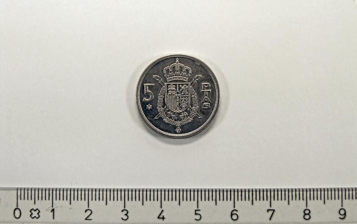 På framsiden:  - Spanias riksvåpen  På baksiden:  - Juan Carlos I