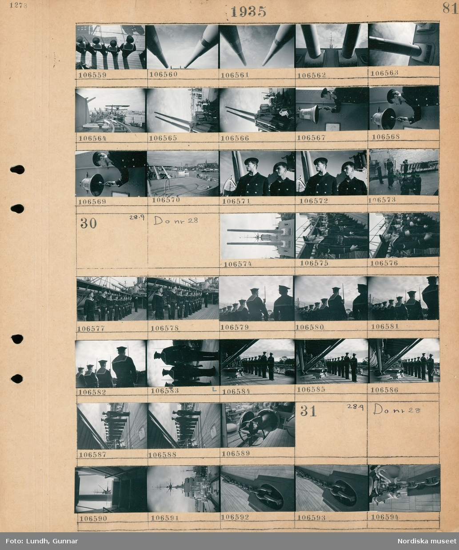 Motiv: Flygplanskryssaren Gotland; Män i uniform står på led med gevär, en kanon, vy över däcket på ett fartyg med ett sjöflygplan, en man i uniform ringer i en skeppsklocka, civila besökare på fartygsdäcket.  Motiv: Flygplanskryssaren Gotland; En kanon, män i uniform står på led med gevär.  Motiv: Flygplanskryssaren Gotland; Vy över fartygsdäck, en kätting.