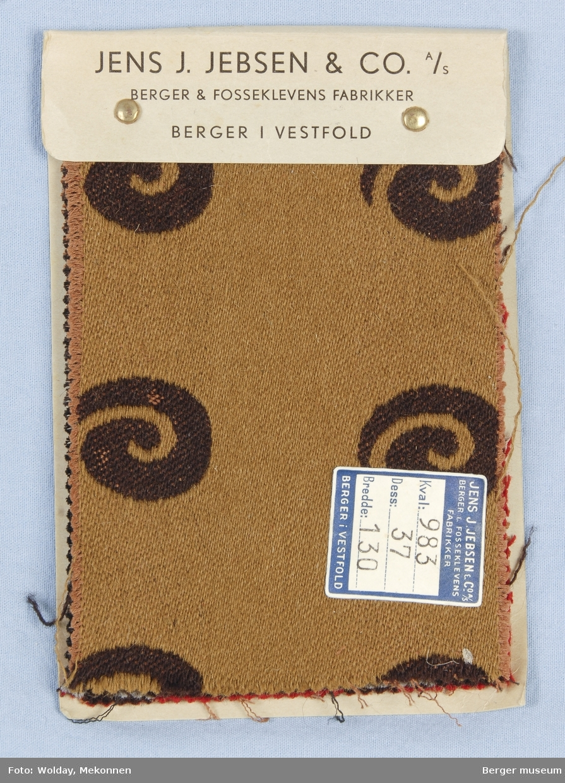 Sneglehus stilisert Møbelstoff. Prøveboka har 3 prøver.