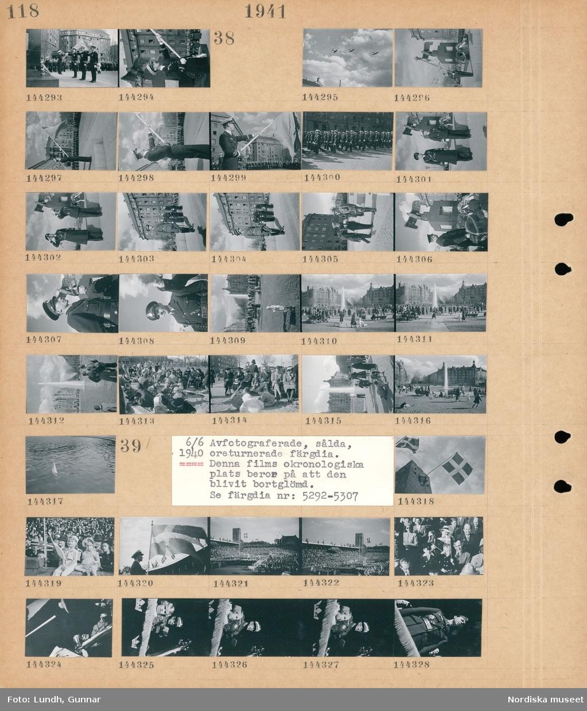 Motiv: (ingen anteckning) ; Tre officerare i uniform gör honnör vid Flygarmonumentet vid Karlaplan.  Motiv: (ingen anteckning) ; Flygplan flyger i formation, militär högtid vid Flygarmonumentet vid Karlaplan, soldater i uniform marscherar inför en folksamling, en folksamling vid en fontän, lekande barn.  Motiv: 6/6 1940 Avfotograferade, sålda, oreturnerade färgdia. Denna films okronologiska plats beror på att den blivit bortglömd. Se färgdia nr : 52929-5307 ; Vy över en publik på Stadion vid firandet av Svenska flaggans dag, Kung Gustaf V, kronprins Gustaf Adolf.