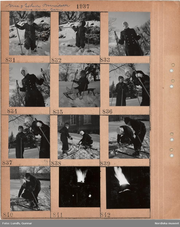 Motiv: Grevinnan Estelle Bernadotte med sina barn, litet barn i vinterkläder med skidstavar, kvinna i vinterkläder med skidstavar, litet barn på kälke i snö, kvinna och pojke på skidor, tänd fackla i mörker.