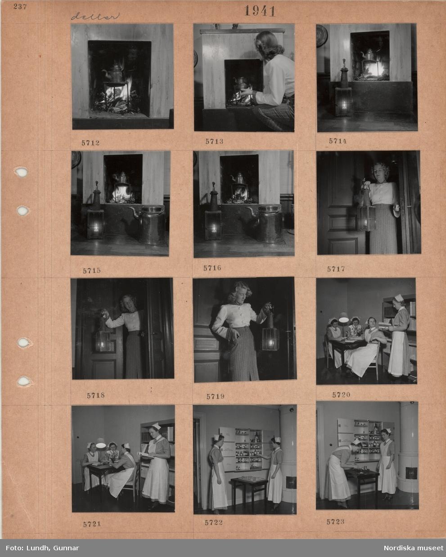 Motiv: Modell som poserar, vid öppen spis med brasa, trefot med kaffepanna i elden, tänd lykta och stor kanna på golvet, kvinna står i dörröppning håller i tänd lykta, interiör med kvinnor i sköterskeuniform som läser och pratar, studierum(?), två unga kvinnor i sköterskeuniform vid skåp med burkar och flaskor, kakelugn.