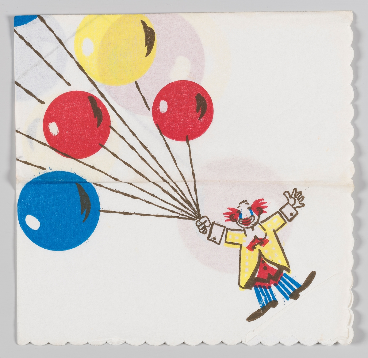 En klovn holder mange fargestrålende ballonger.