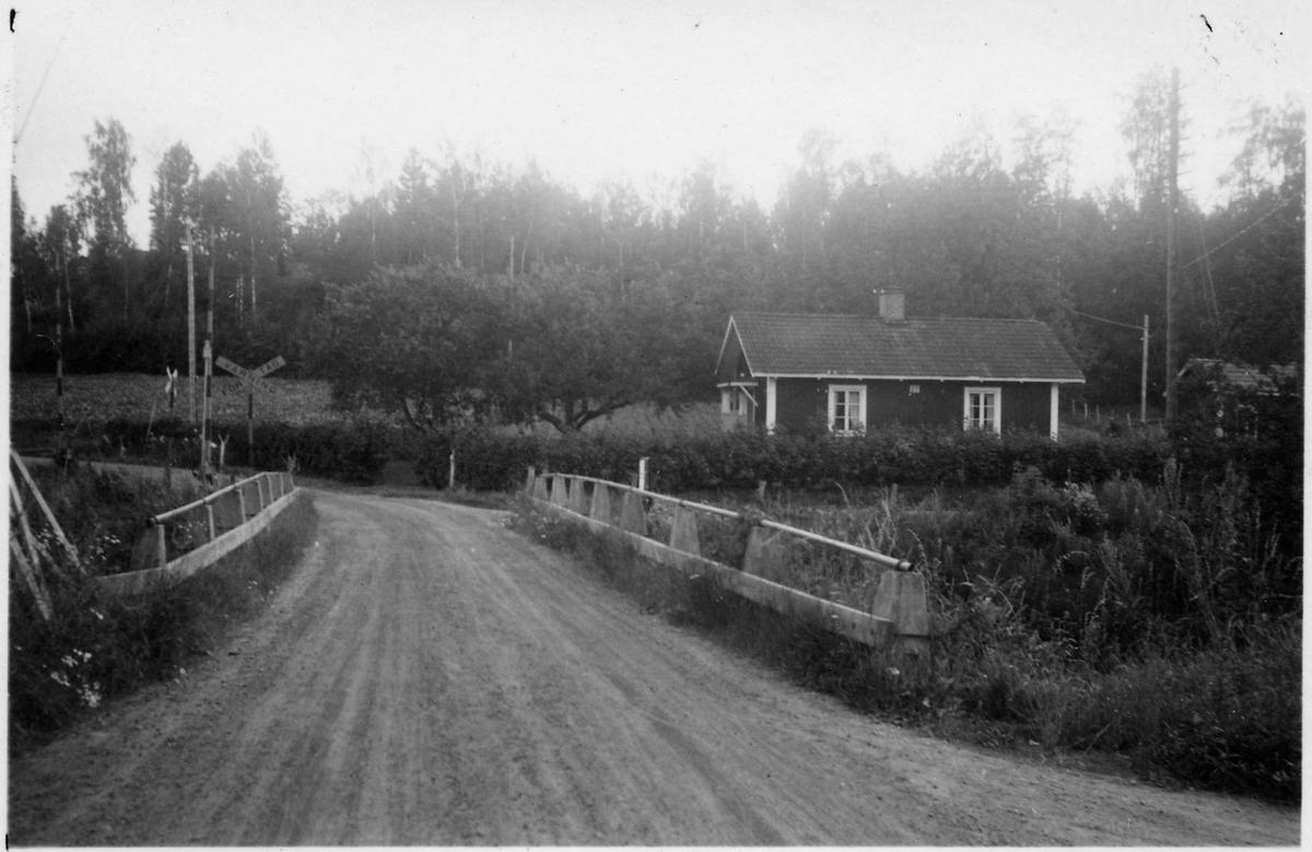 Järnvägsövergång vid Åhaga på linjen mellan Storsjö och Nelhammar.
