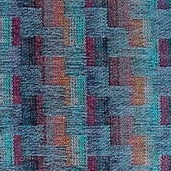 Blått chenilletyg med rektangulära rutor i flera färger. Tyget heter Lord och kommer från 1 klass i  X2000.